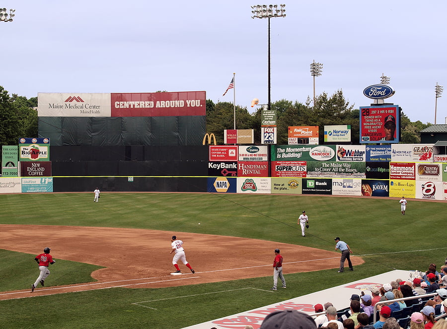 Outfield Advertising at a Minor League Baseball Game